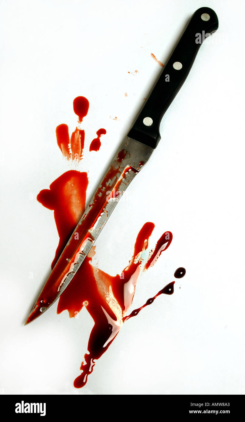 a kitchen knife with blood stains - Stock Image
