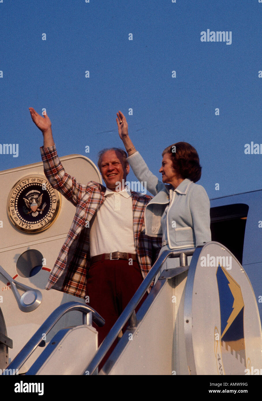 President and Betty Ford waves from the top of the steps of Air Force One arrving in Traverse City Michigan in July - Stock Image