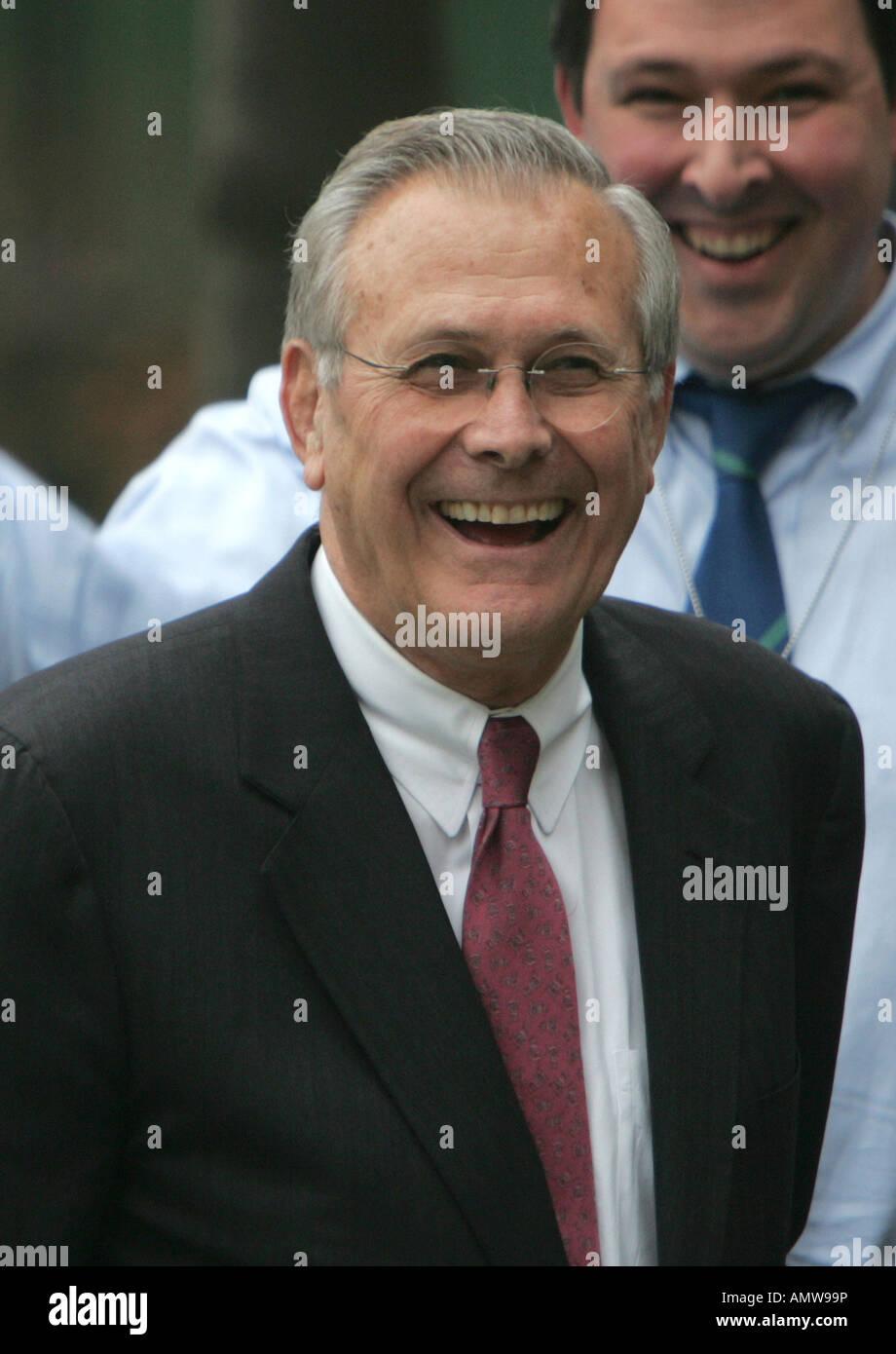 Secretary of Defense Donald Rumsfeld laughs as he departs the White House on November 8, 2006. - Stock Image