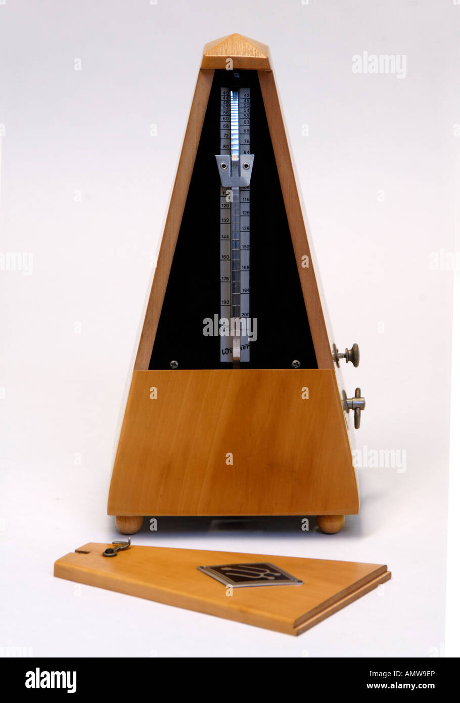 Wittner beechwood clockwork metronome with cover removed . Made in Germany . Stock Photo
