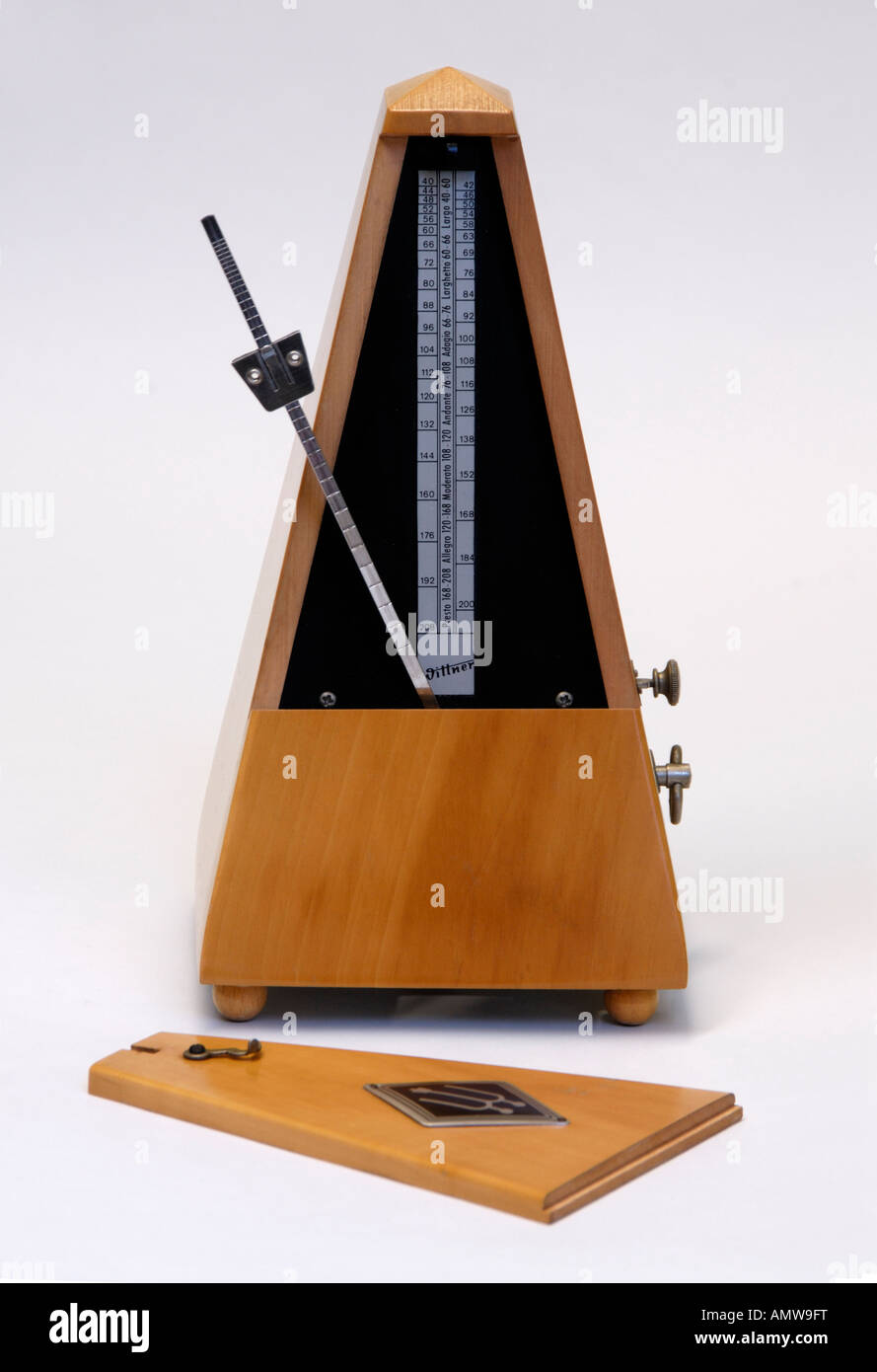 Wittner beechwood clockwork metronome with cover removed. Made in Germany . - Stock Image
