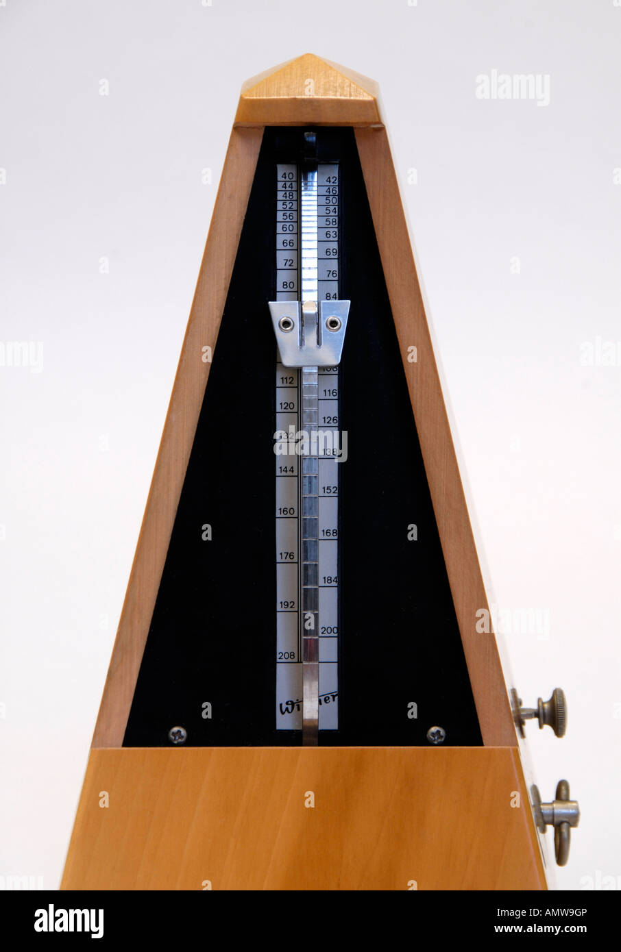 Wittner beechwood clockwork metronome with cover removed . Made in Germany . - Stock Image