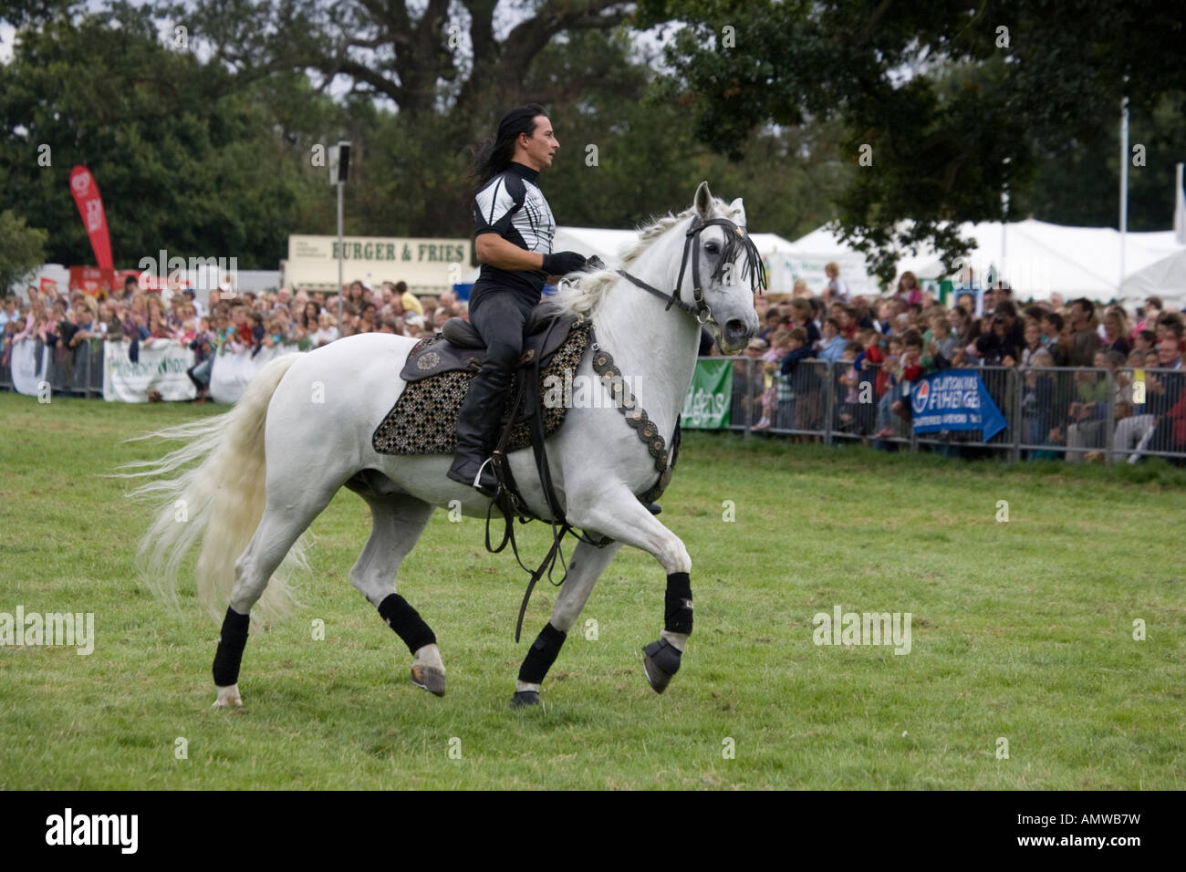 Guido Louis Russian cossack stunt rider Rockin Horse Productions team performing at Moreton Show 2007 Cotswolds - Stock Image
