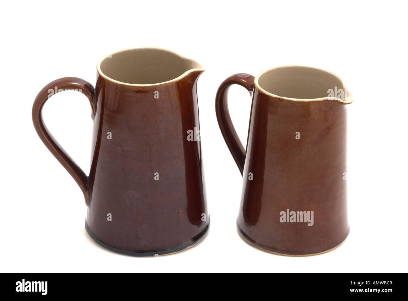 Two old Denby Stoneware brown jugs   'one and a half pint' and 'two pint ' measures - Stock Image