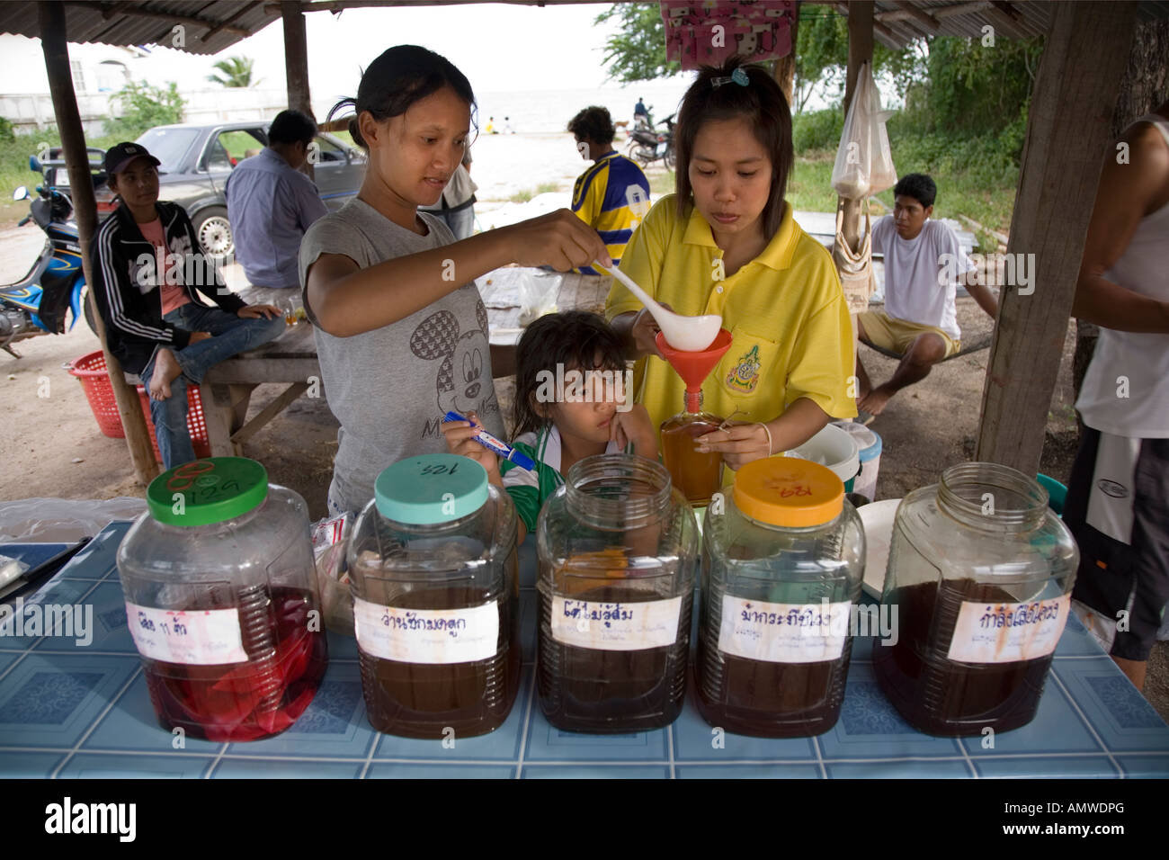 road side stall selling a drink mixed from rum and fruit juice, on the Phala Beach road near Rayong Thailand - Stock Image