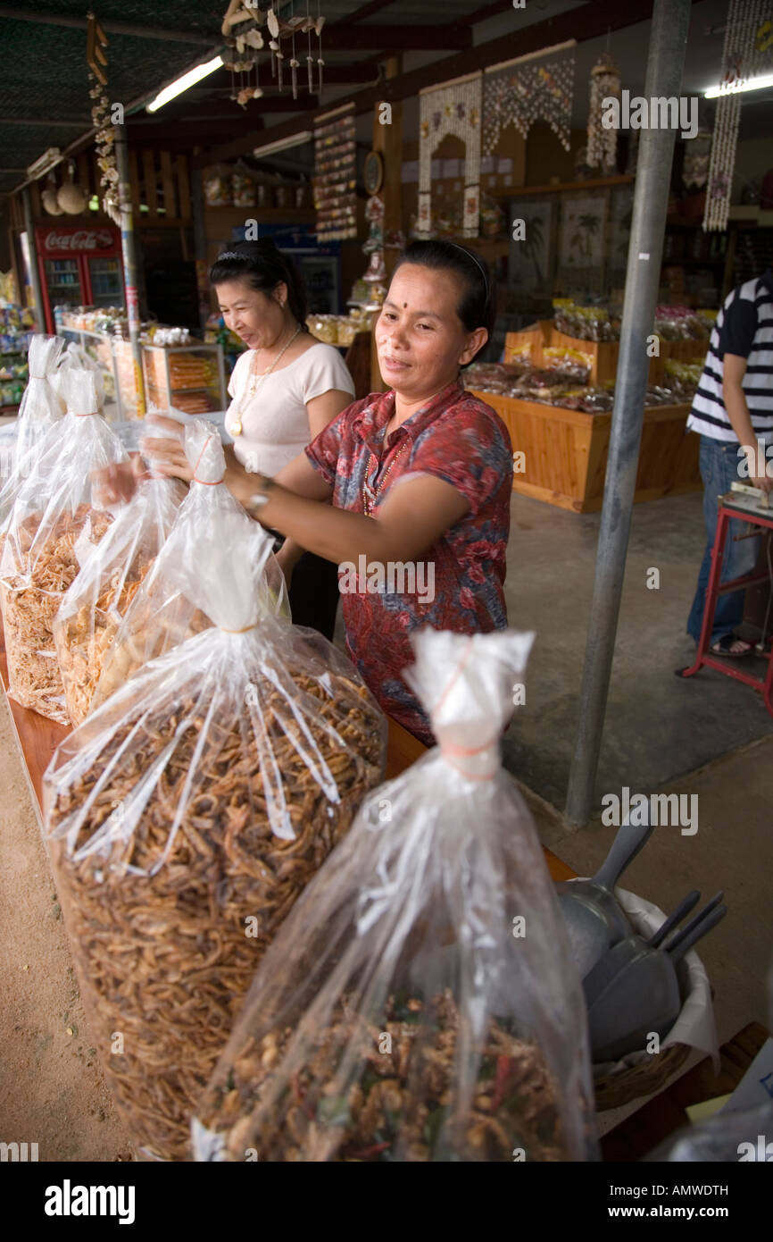A road side stall selling dried fish and seafood snacks on the Phala Beach road near Rayong Thailand Stock Photo
