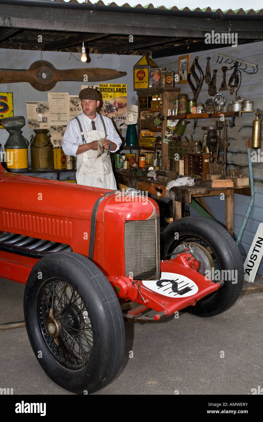 1930's style motor racing garage reconstruction at Goodwood Revival, Sussex, UK. - Stock Image
