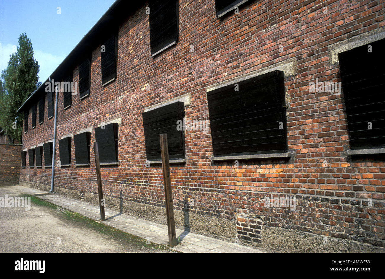 Auschwitz Concentration Block with Boraded Windows preventing prisoners seeing wall of death Stock Photo