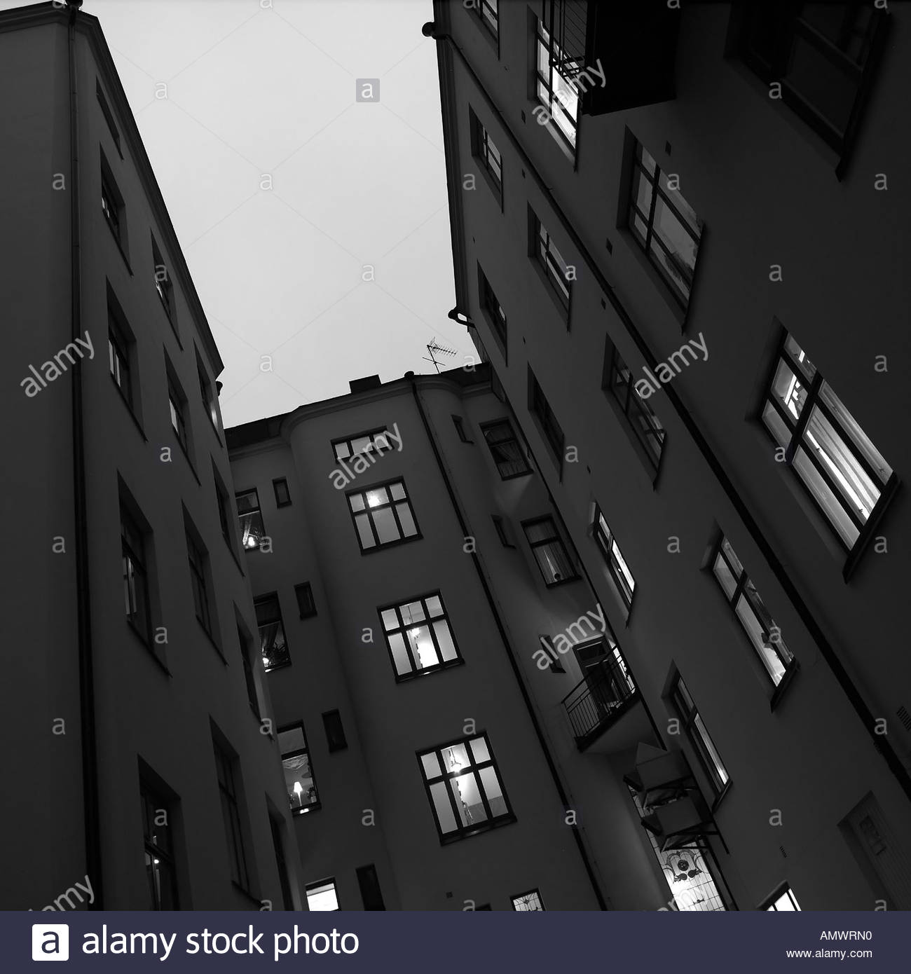 An apartment building in the evening - Stock Image