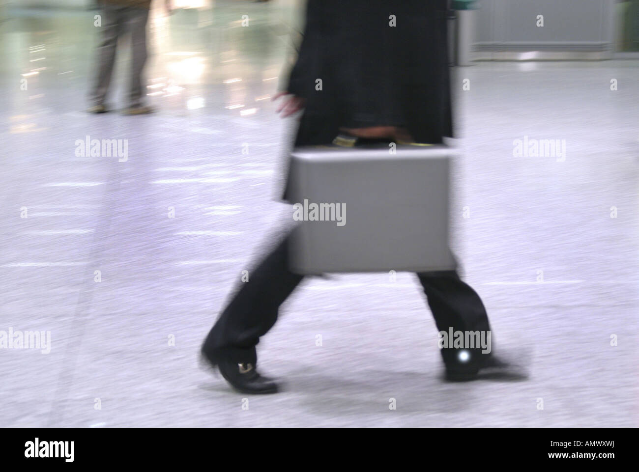 man with briefcase runs hasty to the next meeting - Stock Image