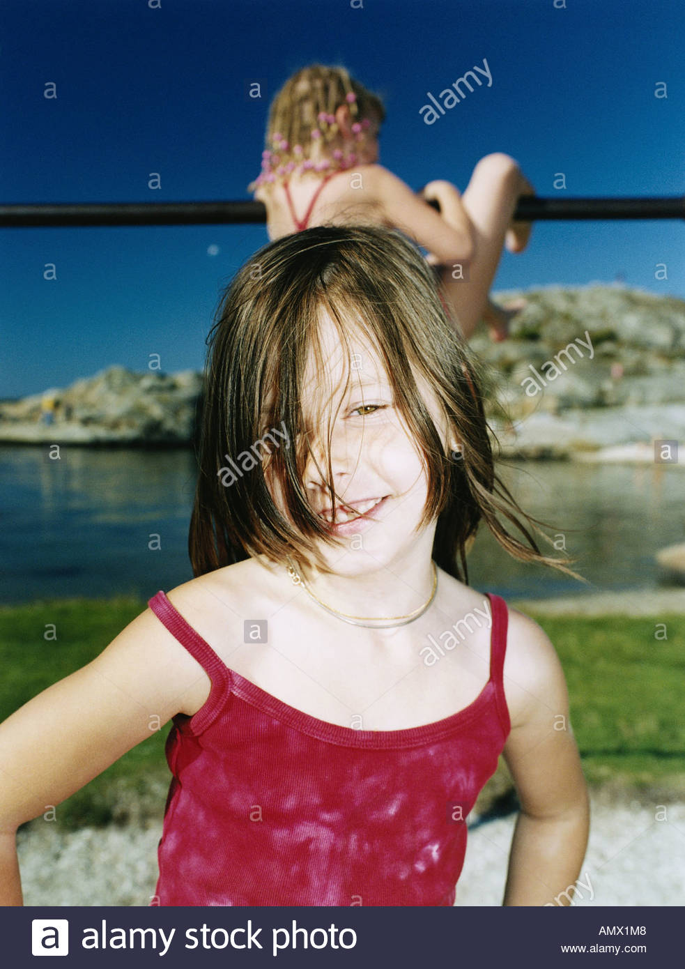 Coquettish little girl on a beach - Stock Image