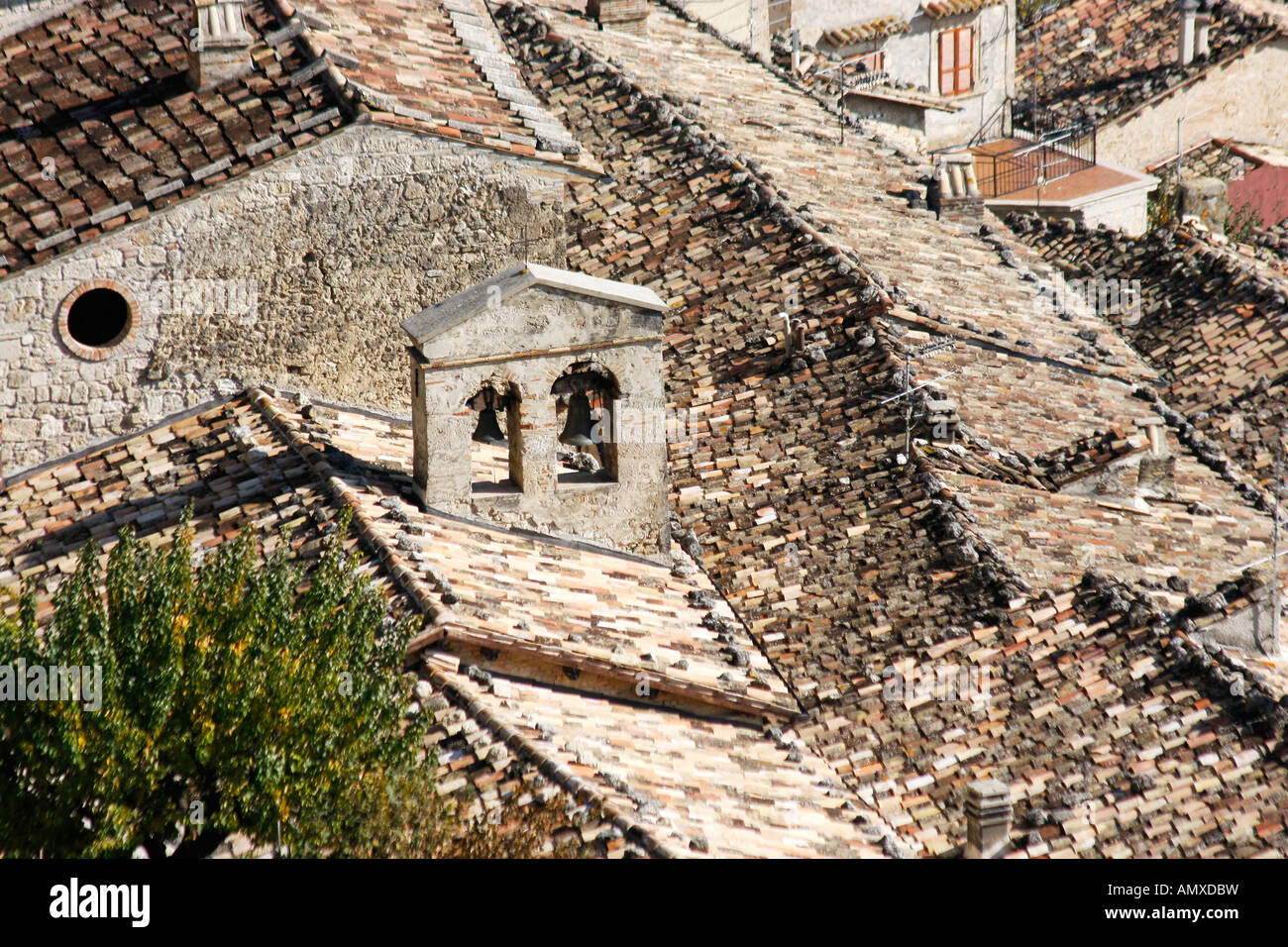 Caldarola roof tops with traditional tiles and a   small bell tower.Le Marche Italy - Stock Image