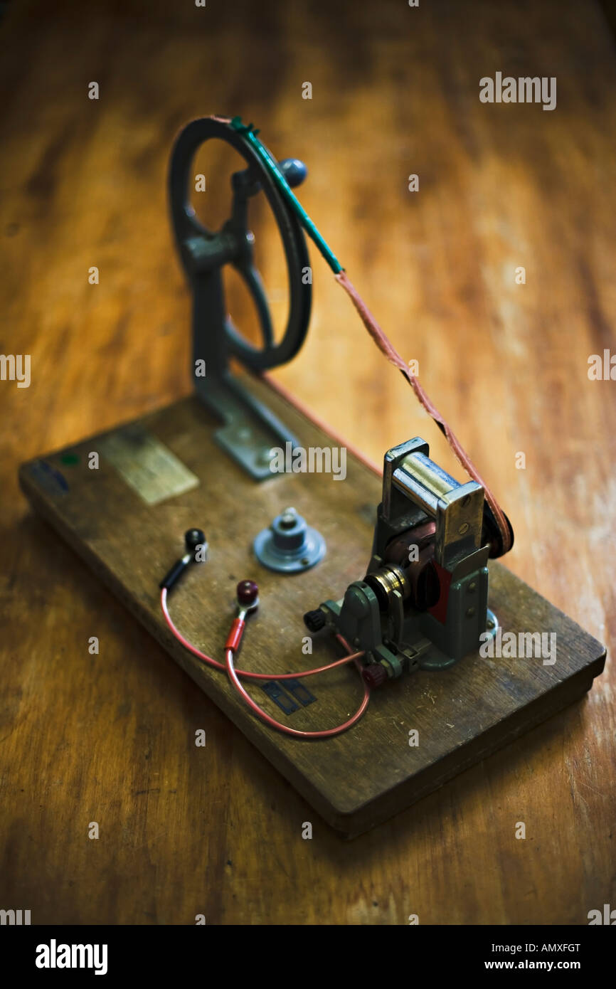 Hand turned electricity generator school physics laboratory equipment - Stock Image