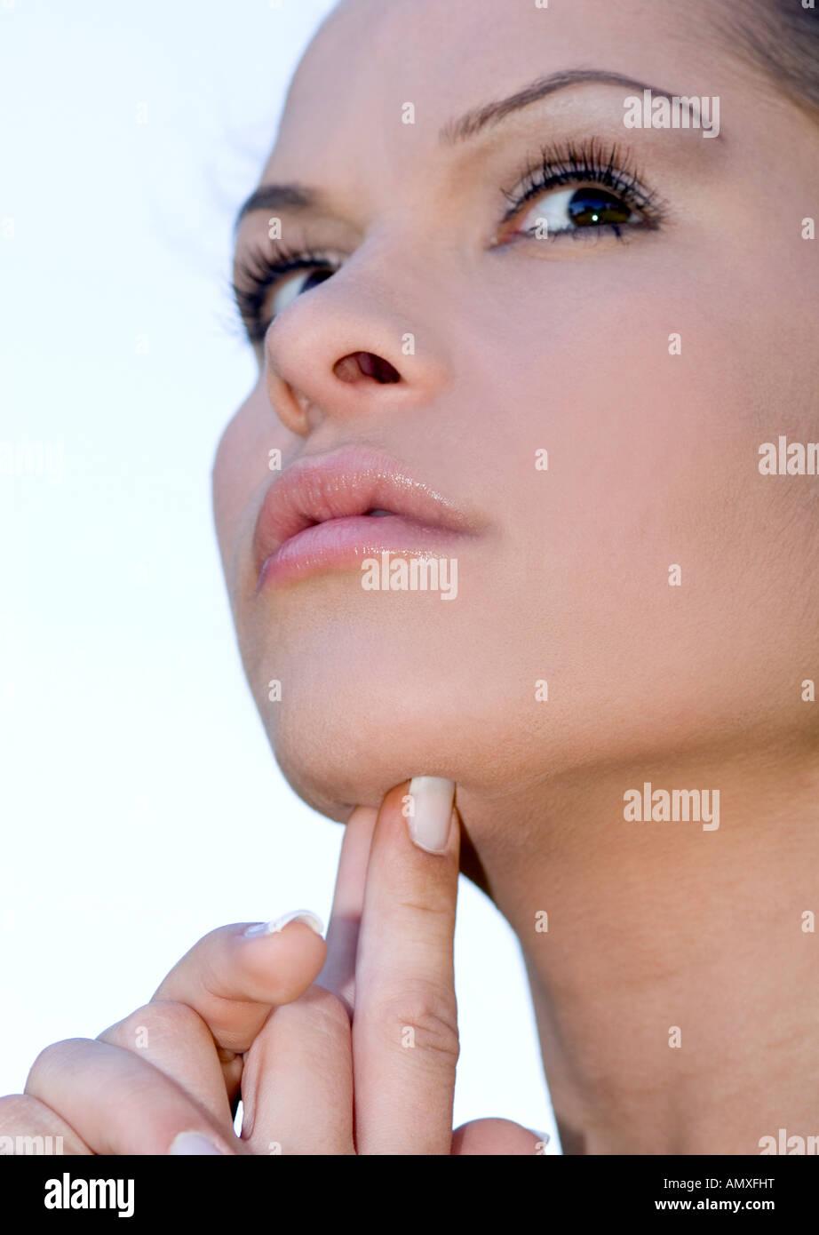Woman touching her chin  Stock Photo
