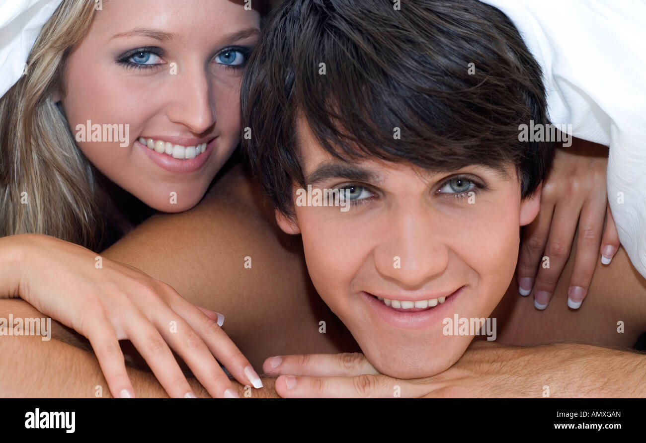 Couple lying in bed Stock Photo