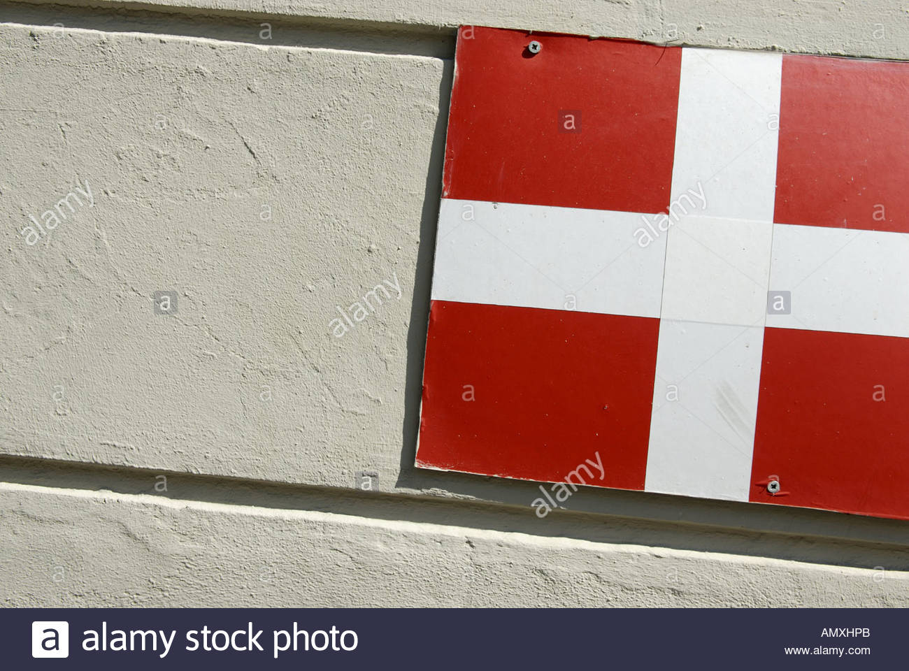 Danish flag Dannebrog on grey wall Copenhagen Denmark - Stock Image