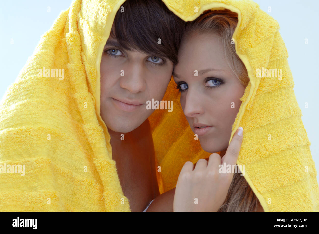 Couple together under a bath towel Stock Photo
