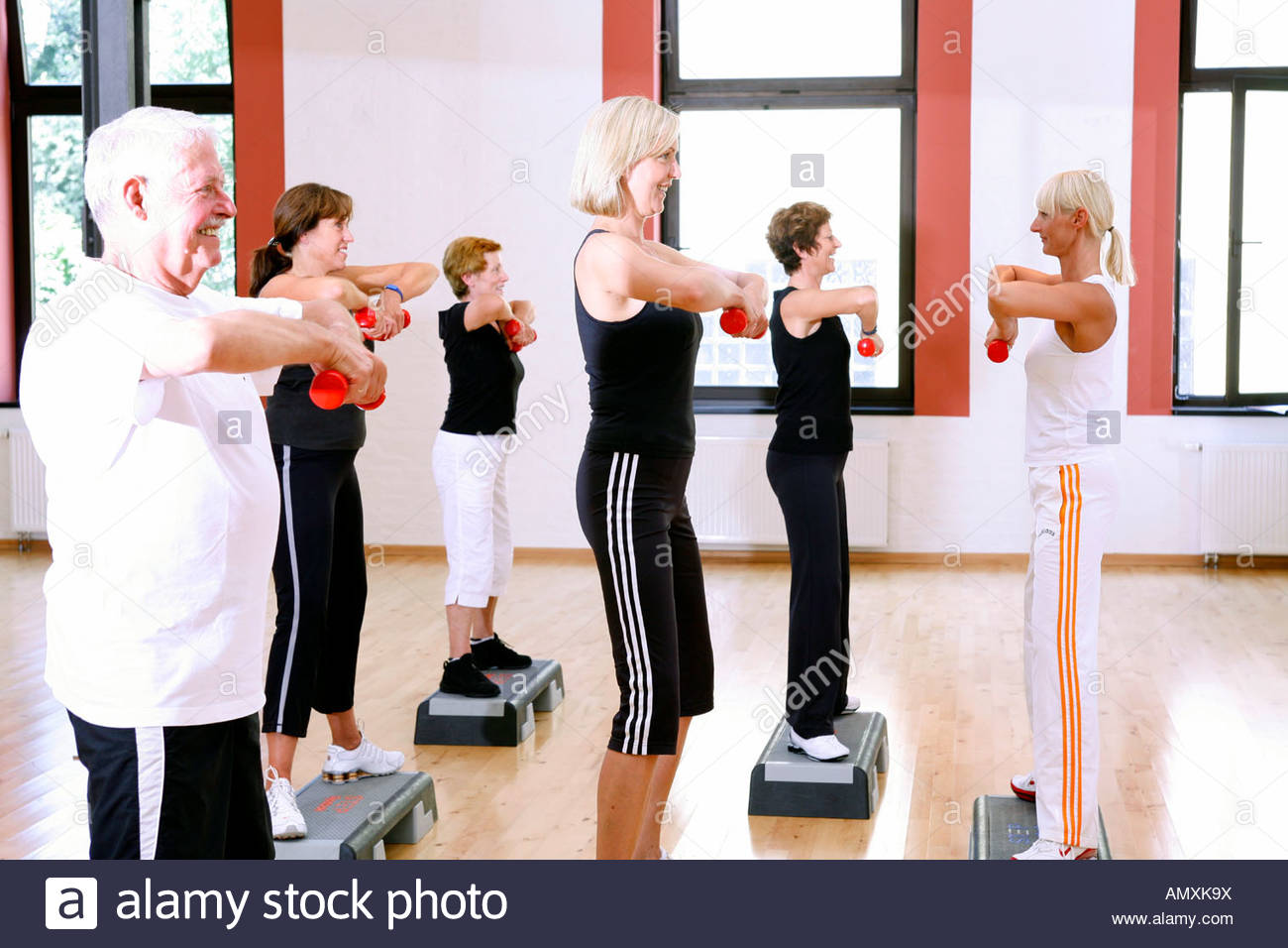 Group of people exercising in gym - Stock Image