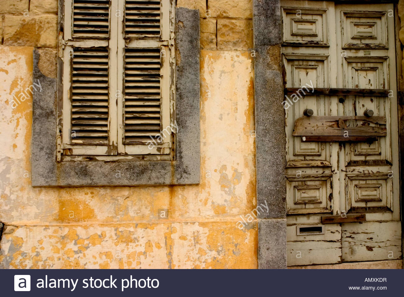 A neglected door, shutter and fascia in Malta - Stock Image
