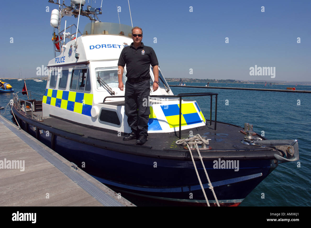Police boat and officer, Dorset, Britain UK Stock Photo