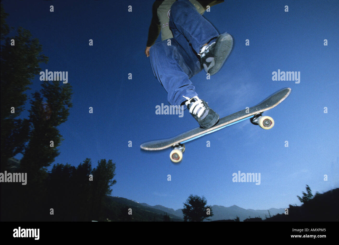 Skateboarder showing footwear. - Stock Image