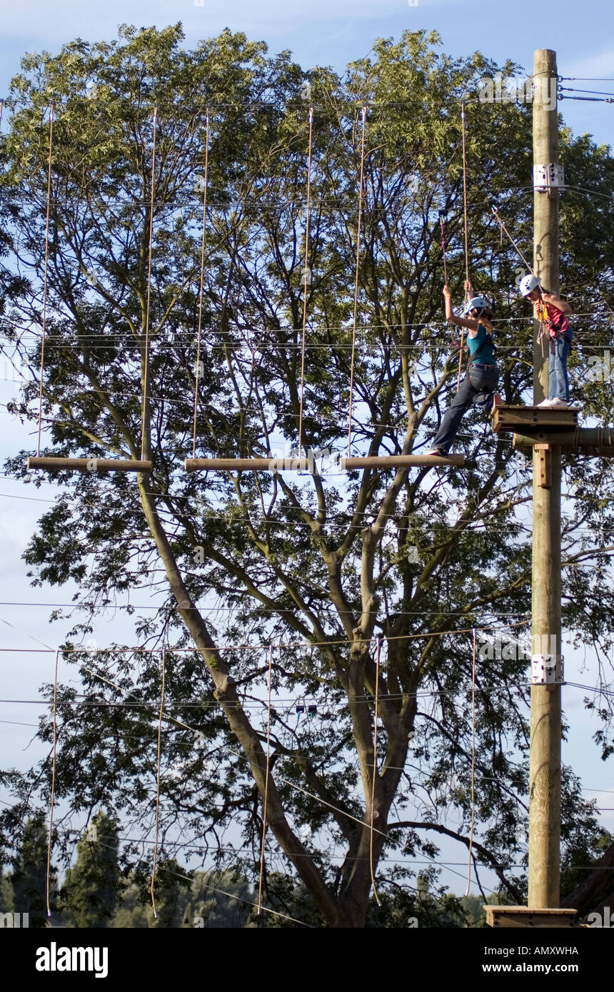 PICTURE CREDIT DOUG BLANE Two young girls on a log bridge at the Aerial Extreme Willen Lake Milton Keynes City of - Stock Image