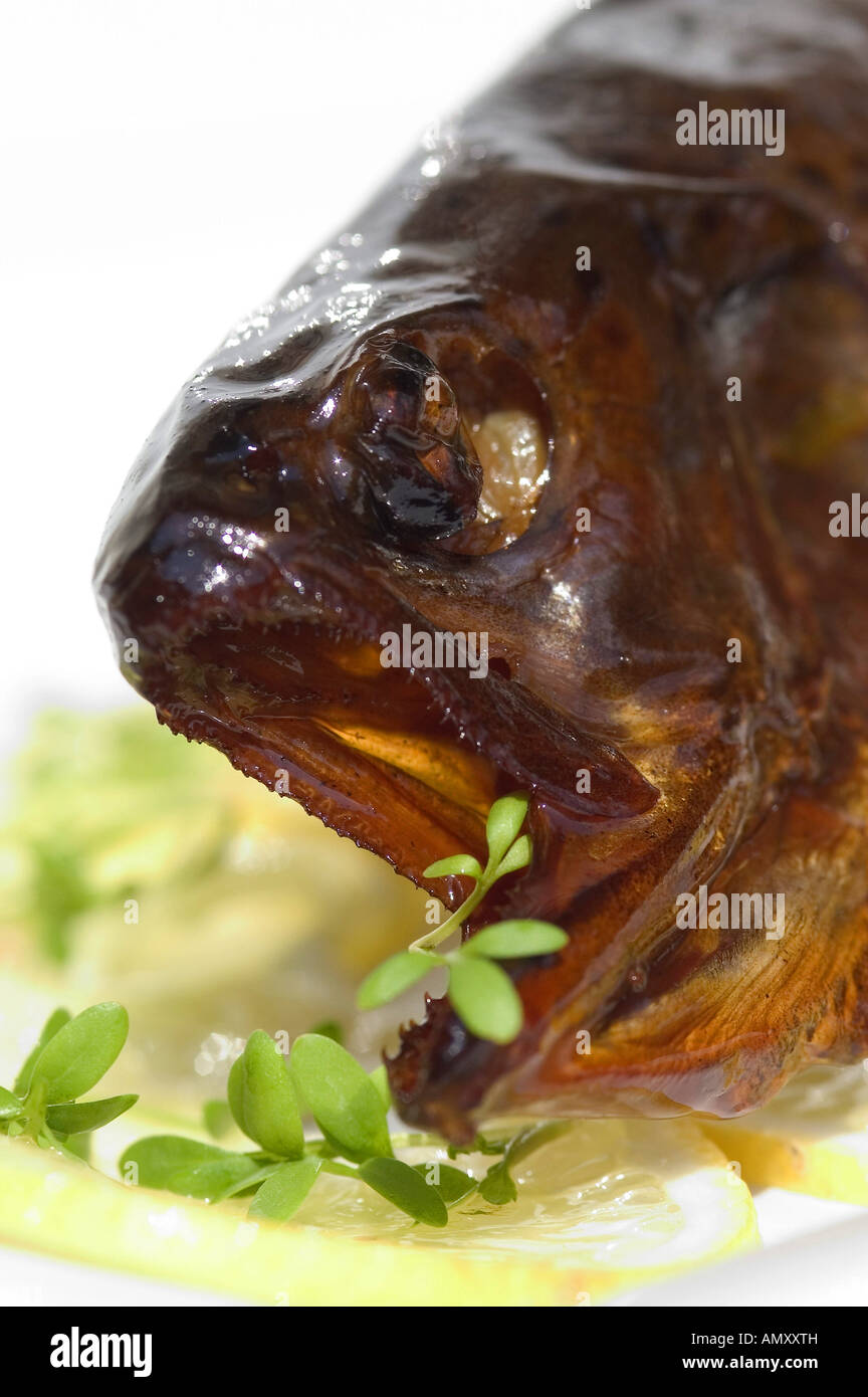head of a fried trout, close-up - Stock Image
