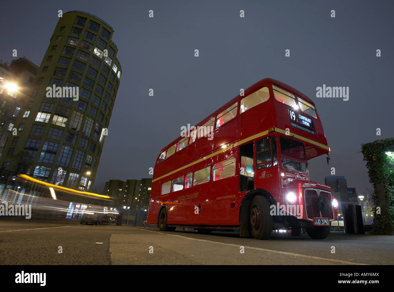 classic red doubledecker london routemaster bus at night in london england uk