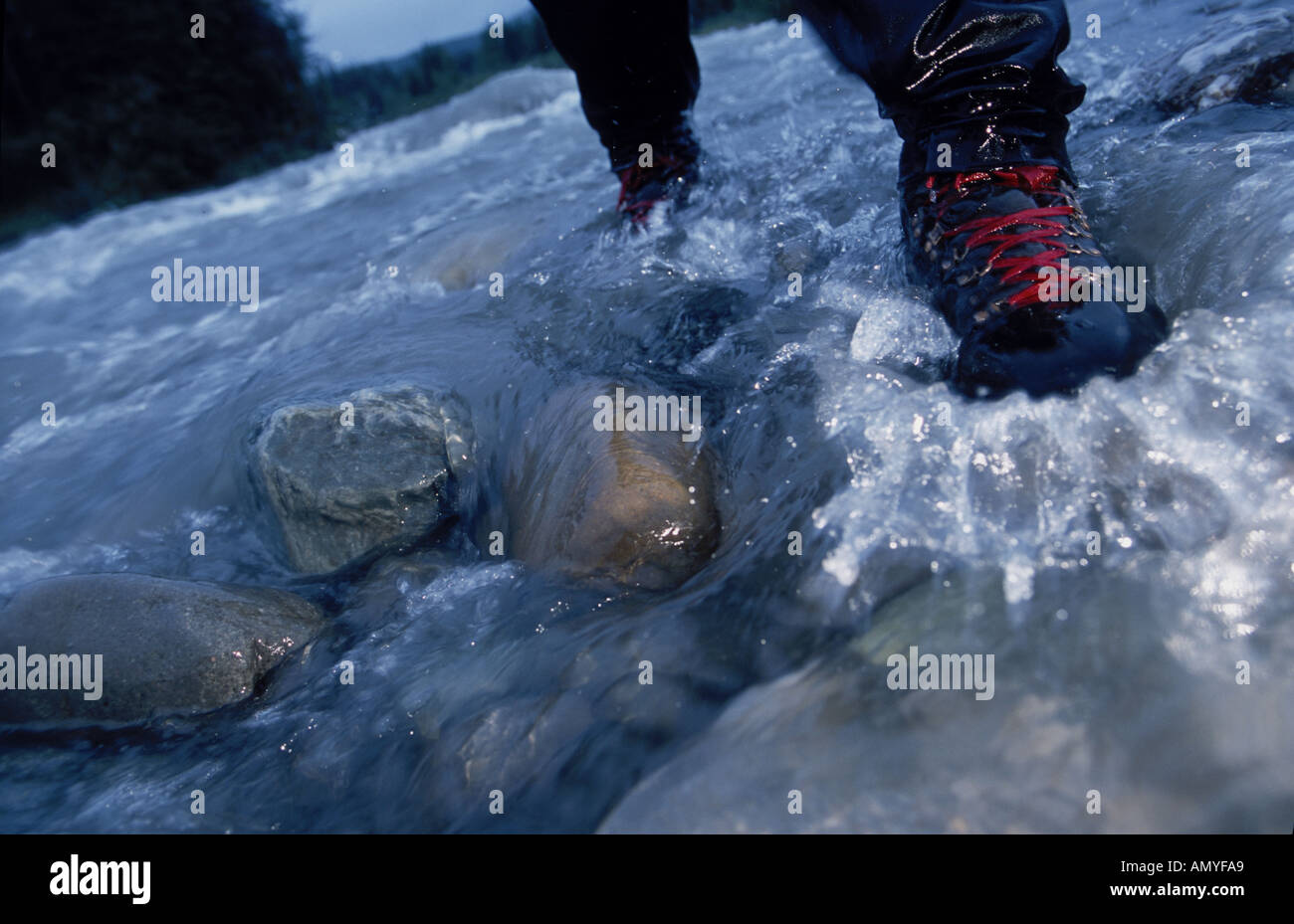 Close up of Hiker s Boot on Rocky Stream Bed Riley Creek - Stock Image