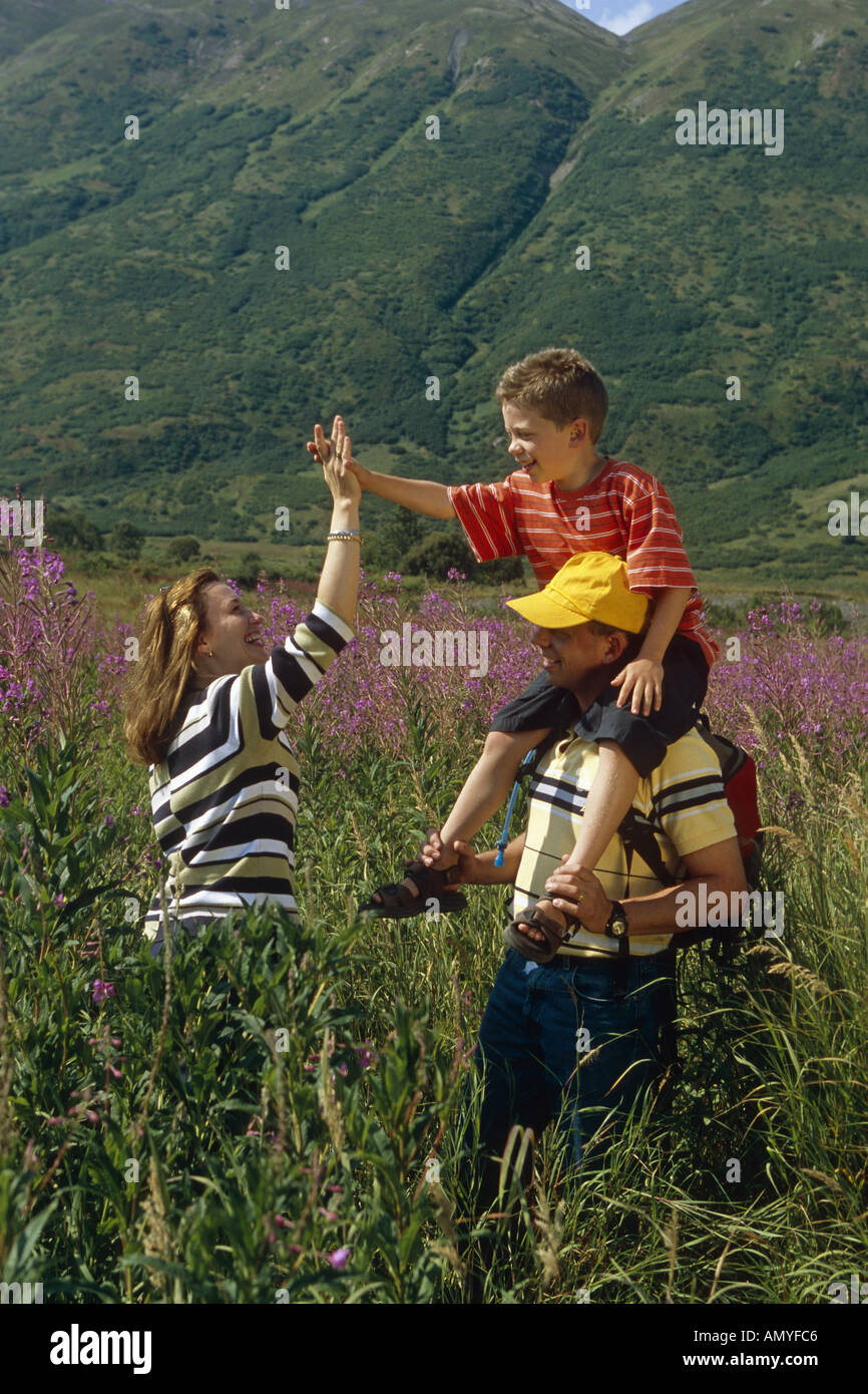 Family Hiking Meadow Together Turnagain Pass AK KP Summer - Stock Image