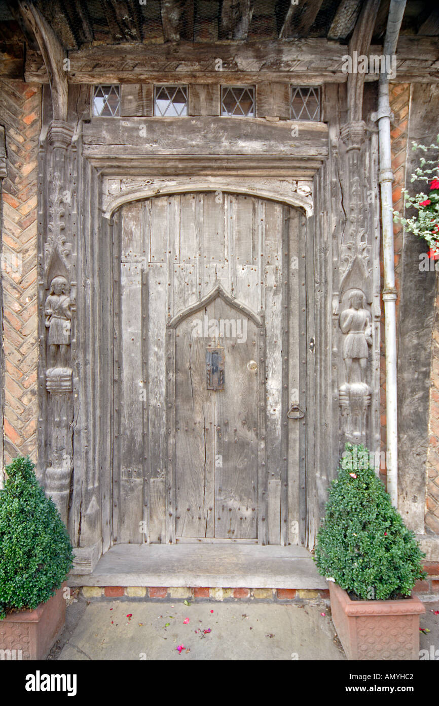 Exquisitly carved medieval gothic timber door at the De Vere House, Lavenham Suffolk East Anglia UK - Stock Image