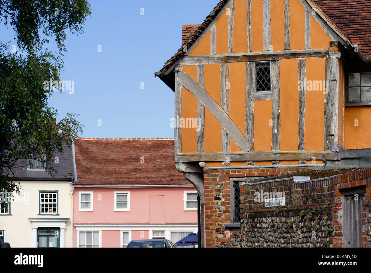 The timber framed C15th gable of Little Hall looking beyond into Market Place Lavenham Suffolk East Anglia UK - Stock Image