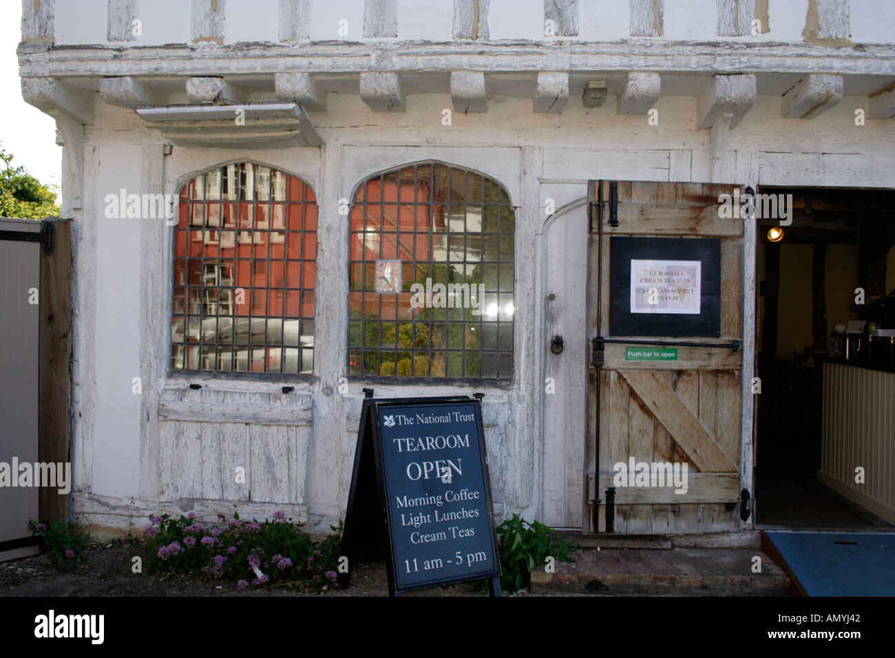 A rare surviving original medieval shop front at the Guildhall Lavenham Suffolk East Anglia UK - Stock Image