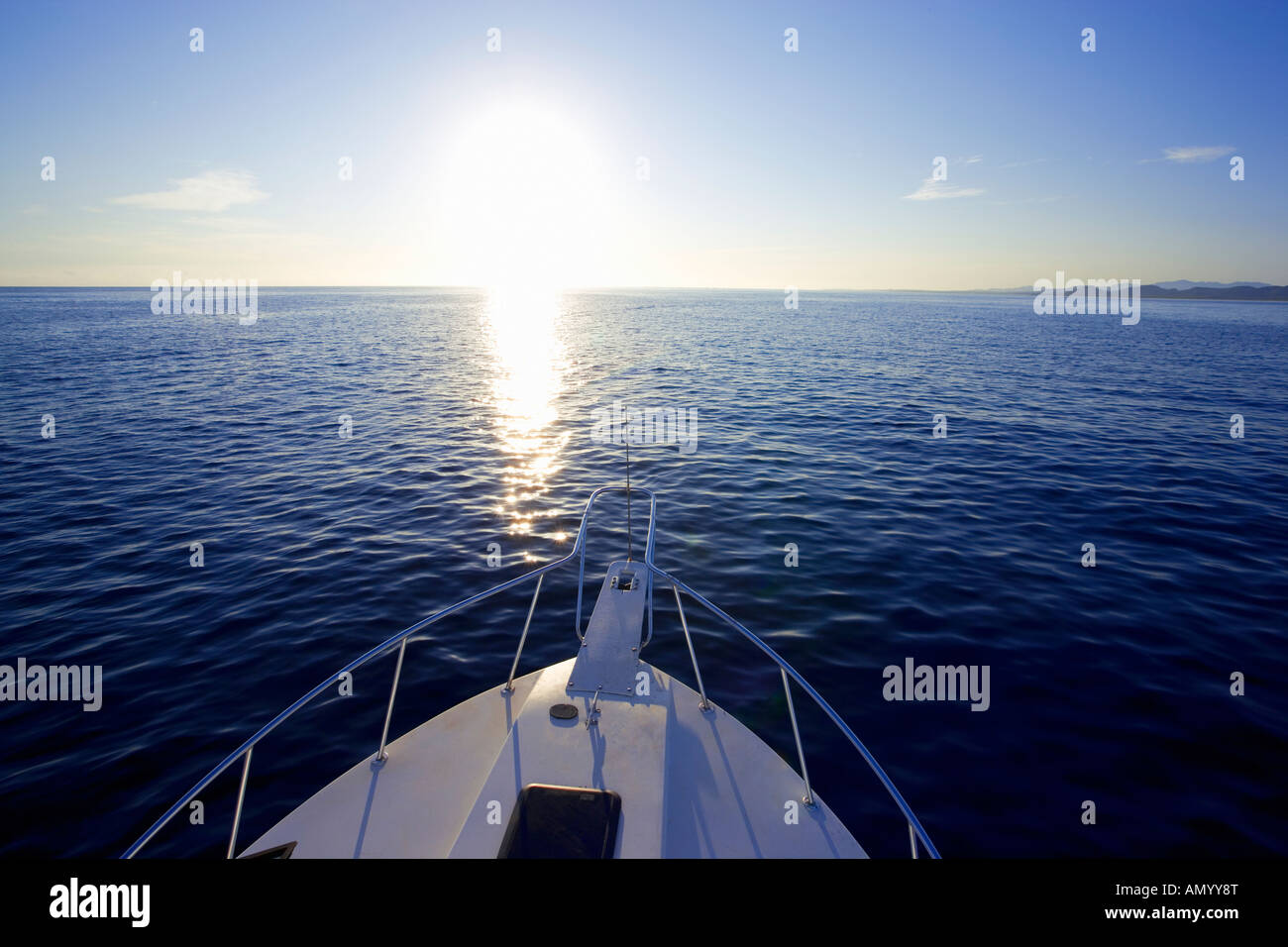 Bow of sport fishing boat yacht facing into sunrise offshore in Baja, Mexico - Stock Image