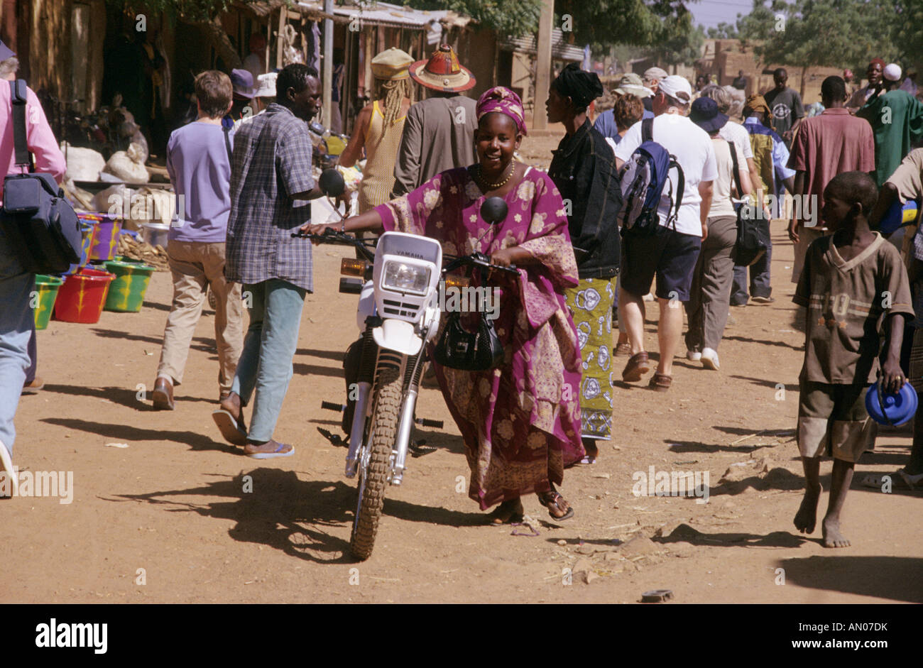 Mali Djenne  Market Woman with Yamaha bike - Stock Image