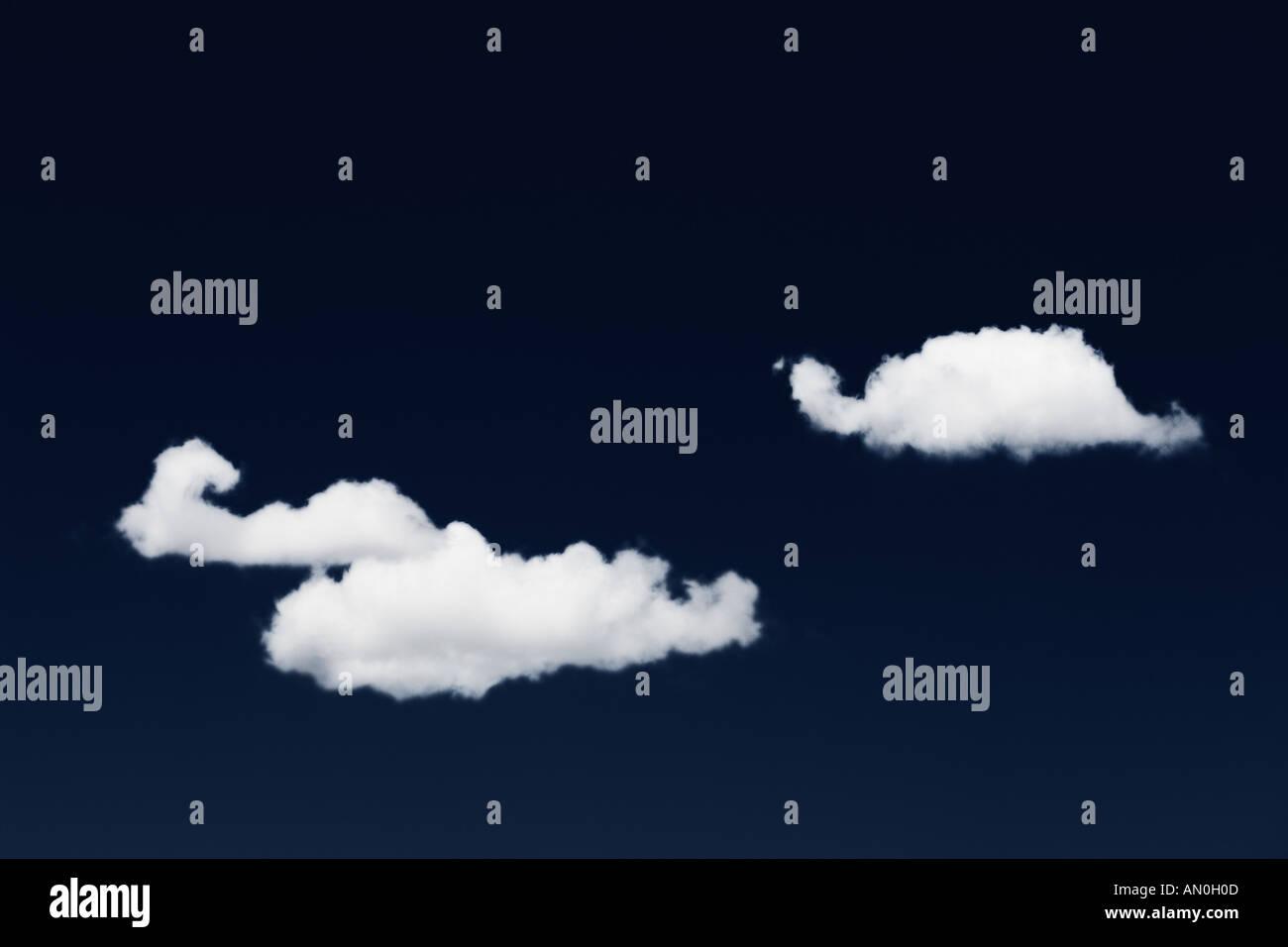 Three Clouds And Dark Blue Sky - Stock Image