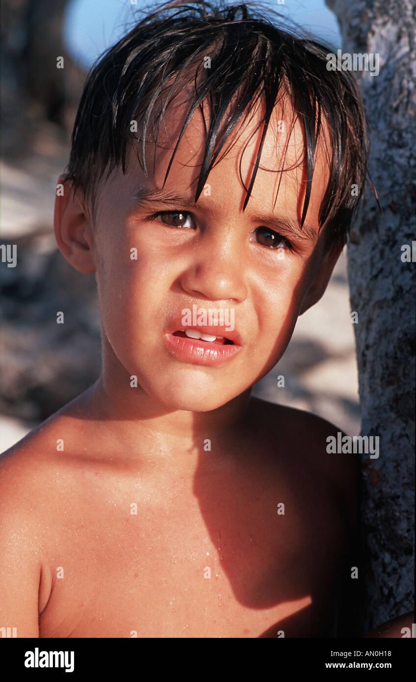 Portrait of a Cuban boy at Playa Pesquero near Guadarlavaca Holguin province Cuba - Stock Image