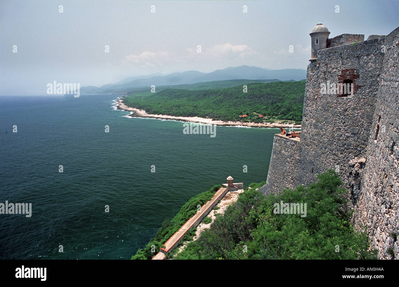 Sierra Maestro Mountains beyond the sea viewed from the El Morro fortress at Santiago de Cuba CUBA - Stock Image