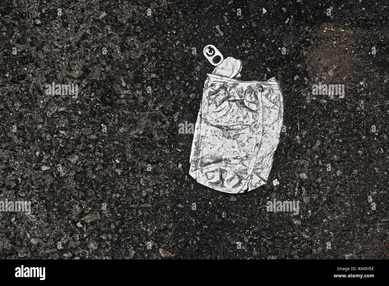 Crushed Soft Drink Can On Asphalt Manhattan - Stock Image
