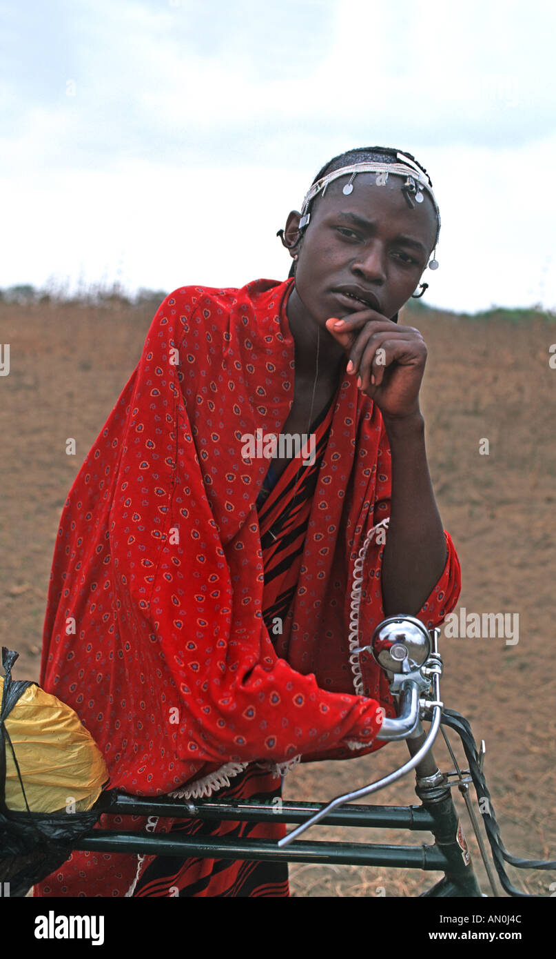 Masai warrior in tribal dress Proud owner of a bicycle Tribal community nr the cattle market N of Arusha Tanzania E Africa - Stock Image