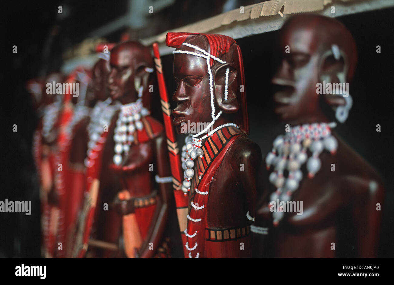 Selection of hand made sculptures of Masai warriors sold as souvenirs on a market stall As sold throughout Kenya and Tanzania - Stock Image