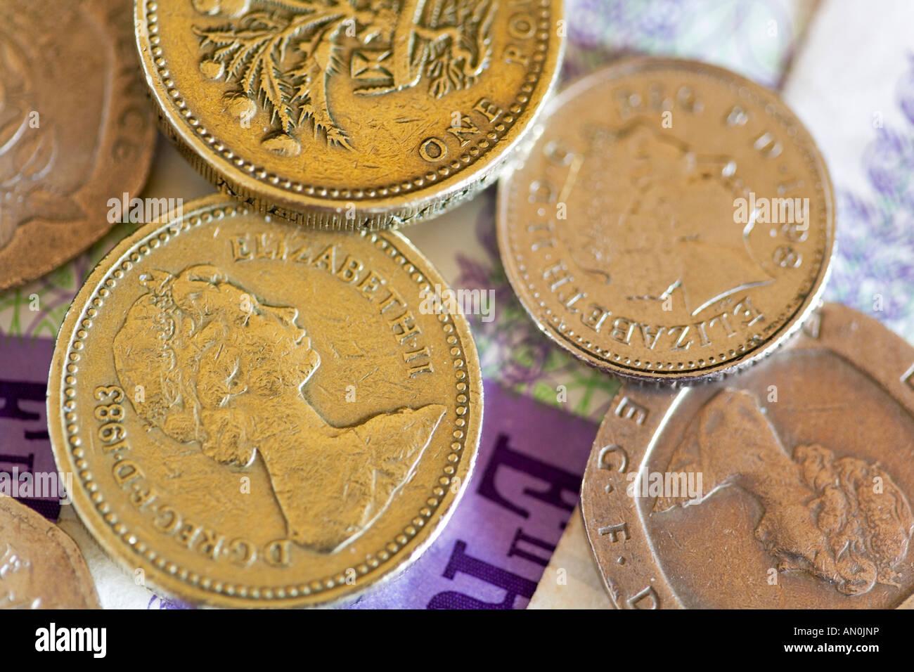Assortment of English coins on Twenty pound notes - Stock Image