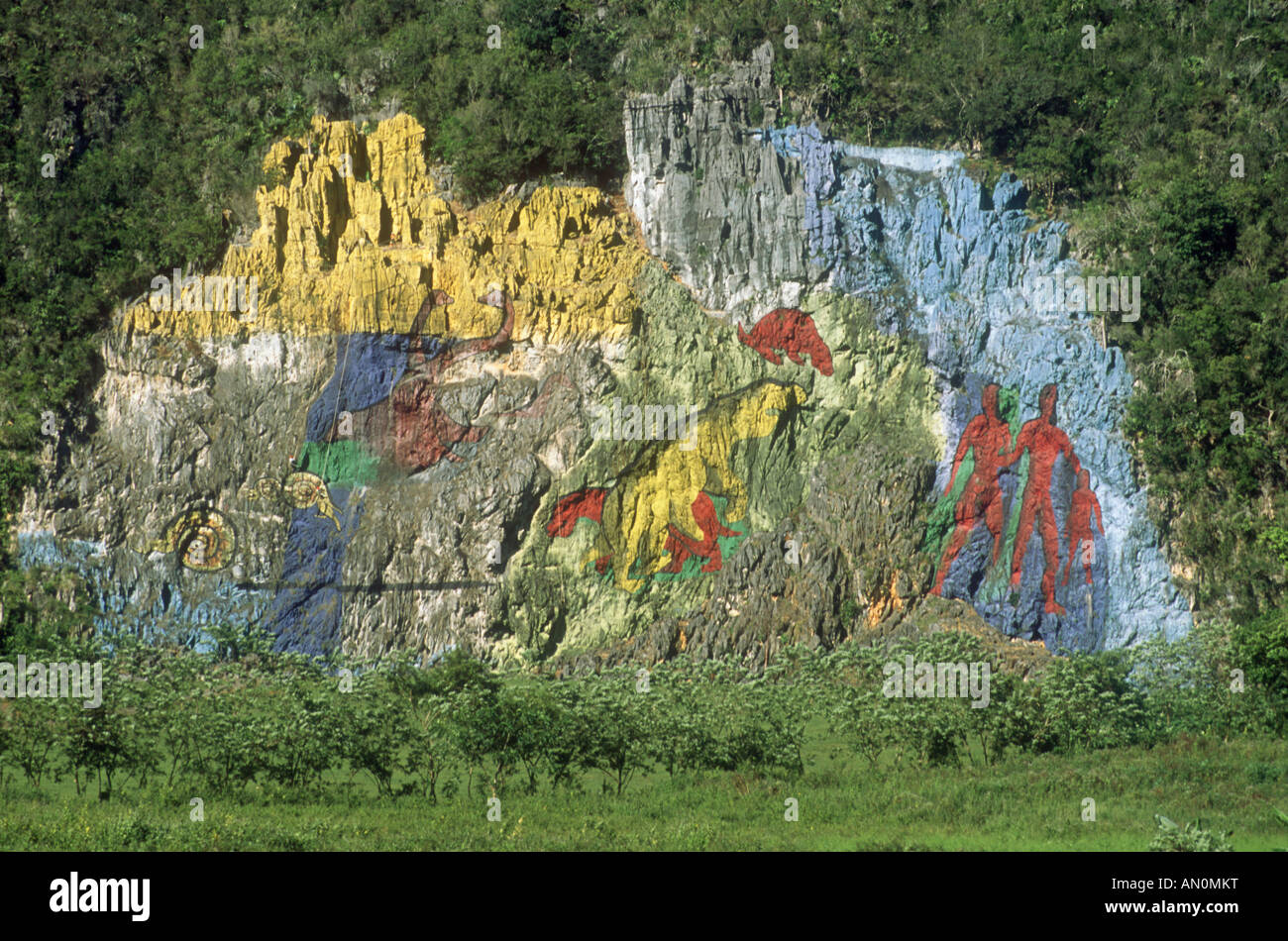Mural painted on the side of a Mogote or limestone outcrop near Vinales, Cuba. - Stock Image