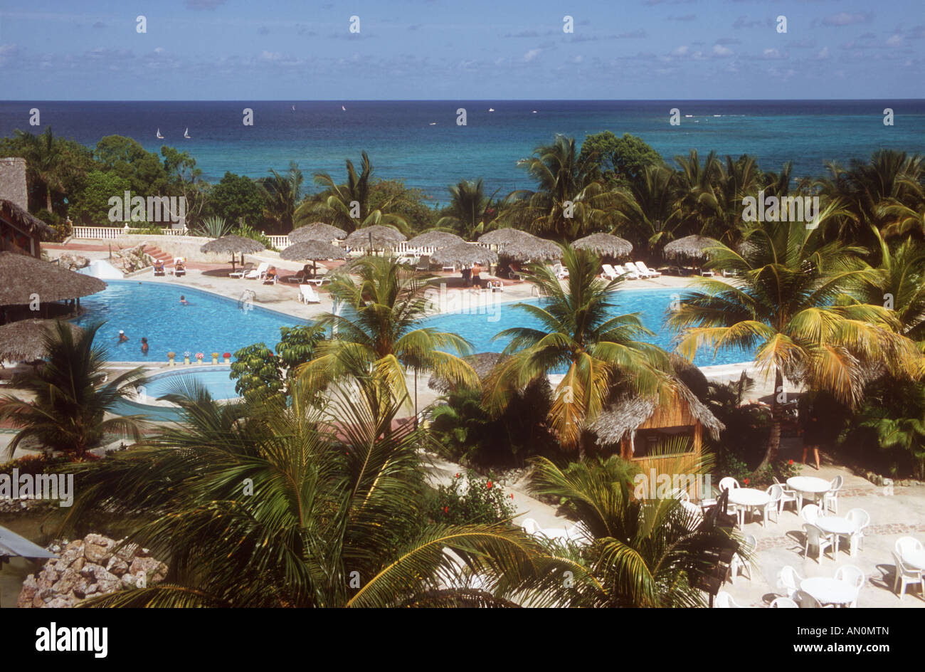 View From Balcony Of Luxury Beach Resort Near To Guardalavaca Cuba Showing The Pool Palm Trees And Sea In Distance