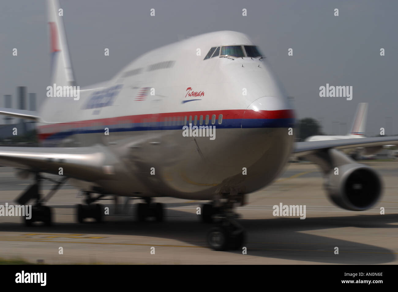 Jumbo Jet taxing at airport with motion blur Stock Photo
