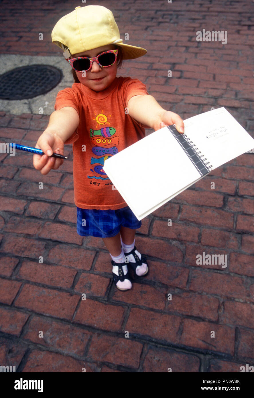 Young Fan aking for an autograph - Stock Image
