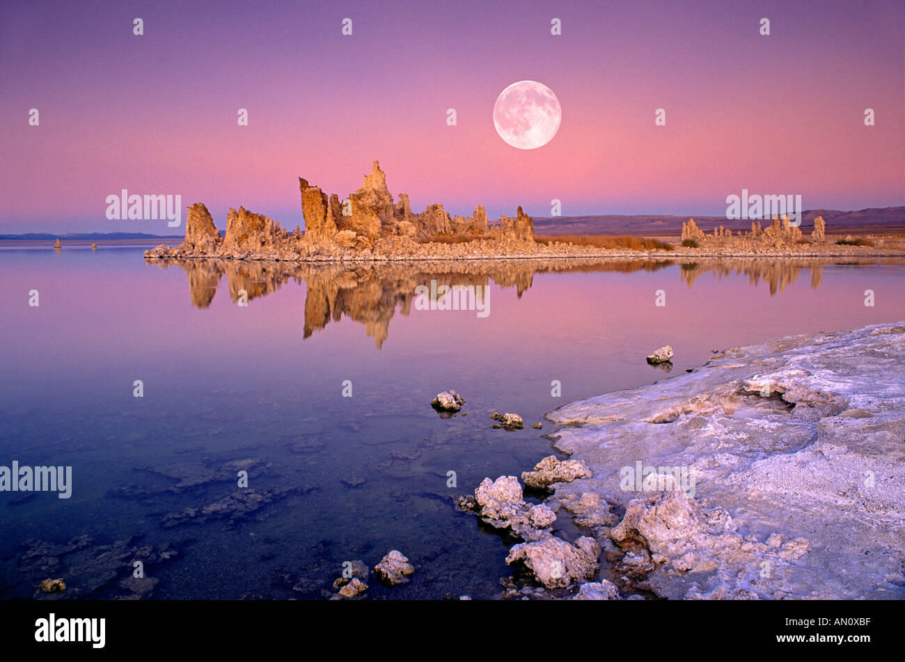Full moon over off shore tufa formations at dusk along the south shore of Mono Lake Mono Basin National Scenic Area Stock Photo