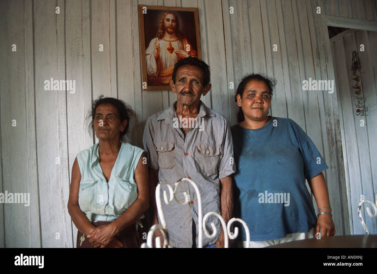 Family group with woman standing with her father and mother in farmhouse near Vinales, Pinar Province, Cuba. Stock Photo