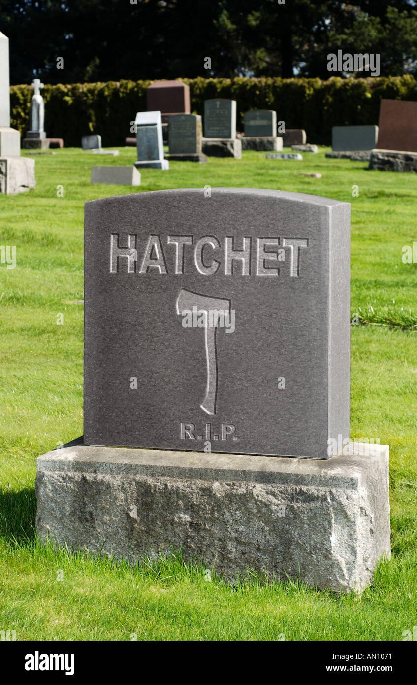 Bury the Hatchet Tombstone with word Hatchet and hatchet outline on it - Stock Image