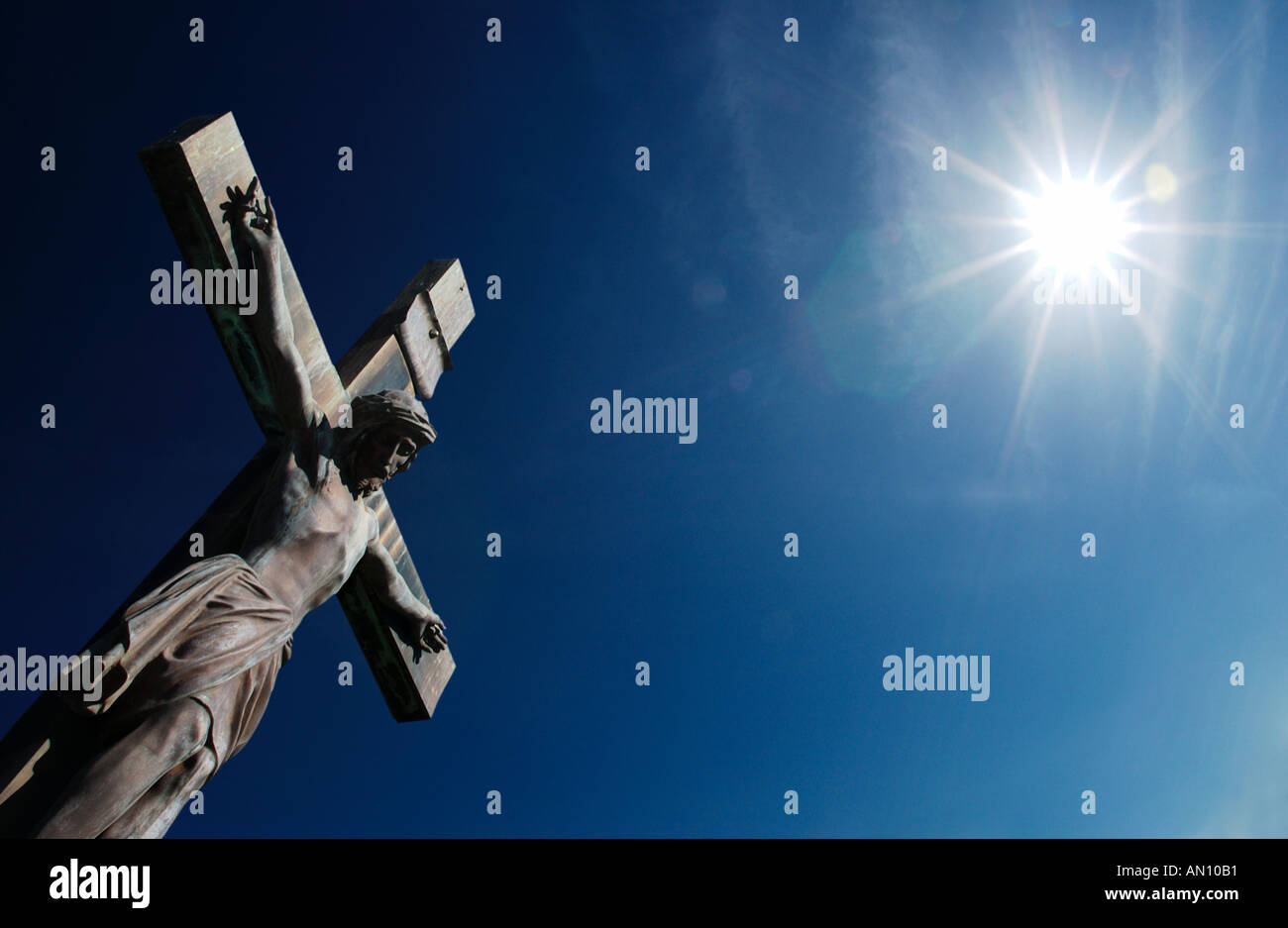 Statue of Jesus Christ on Cross with sunshine - Stock Image